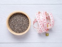 chai seeds and tape measure on white wooden table